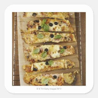 Pizza cut into pieces square sticker