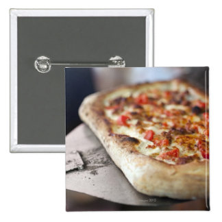 Pizza with tomatoes, garlic and meat substitute buttons