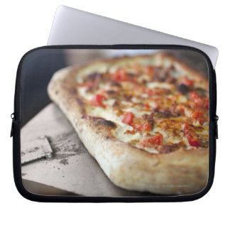 Pizza with tomatoes, garlic and meat substitute laptop sleeve