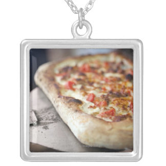 Pizza with tomatoes, garlic and meat substitute pendants