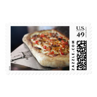 Pizza with tomatoes, garlic and meat substitute postage stamp