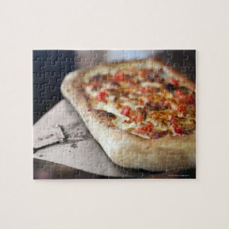 Pizza with tomatoes, garlic and meat substitute puzzles
