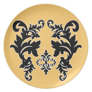 Placa blanco y negro del modelo del oro amarillo d platos