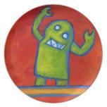 Placa con el individuo verde del robot plato de comida