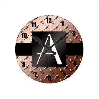 Placa de acero del diamante marrón del monograma relojes