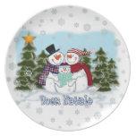 Placa de Buon Natale de la familia del muñeco de n Plato