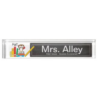 Placa de identificación del profesor del pequeño b