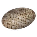 Placa de la textura de la cesta platos