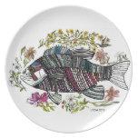 Placa de los pescados y de las flores platos de comidas