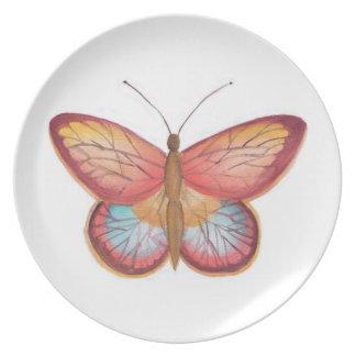 Placa de mariposa multicolora roja plato de comida