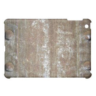 Placa de metal oxidada con los tornillos