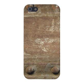 Placa de metal oxidada con los tornillos iPhone 5 cárcasas