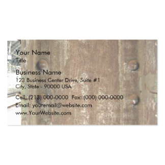 Placa de metal oxidada con los tornillos tarjeta de negocio