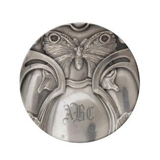 Placa de plata de la antigüedad del monograma de l platos de cerámica