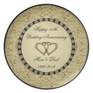 Placa del aniversario de boda de oro plato de comida