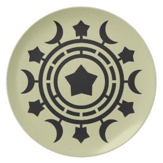 Placa del diseño de las lunas y de las estrellas platos