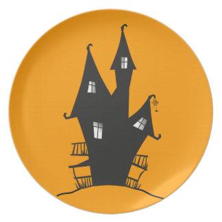 Placa del fiesta de la casa de la bruja platos