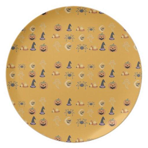 Placa fantasmagórica anaranjada de los iconos de l platos de comidas