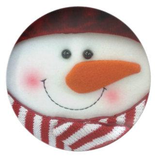 Placa feliz del día de fiesta del muñeco de nieve plato de comida