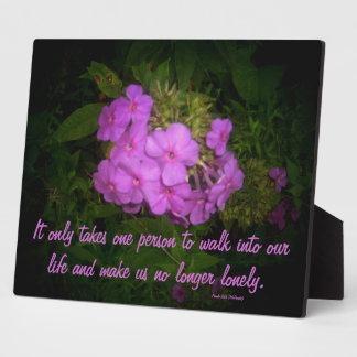 Placa floral del refrán