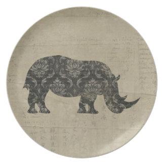 Placa negra de la silueta del rinoceronte del platos