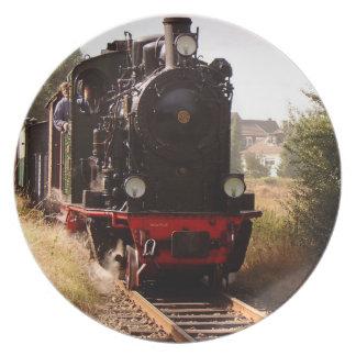 Placa negra del navidad del motor de vapor de la v platos de comidas