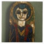 Placa redondeada, representando Cristo o a un sant Azulejo