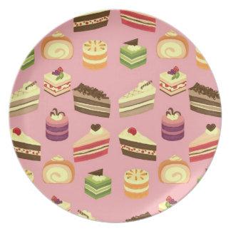 Placa (rosada) de la comida fría de la torta platos de comidas