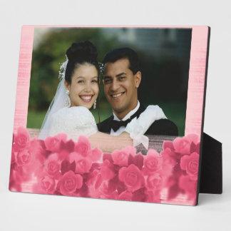 Placa rosada de la foto de los rosas