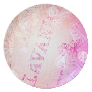Placa rosada del estampado de flores platos