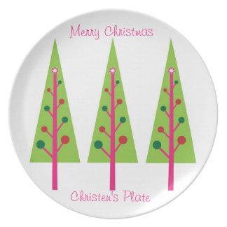 Placa rosada y verde del árbol de navidad plato