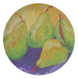 Placa verde de las peras plato de comida