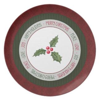 Placa verde roja del día de fiesta del acebo del platos para fiestas