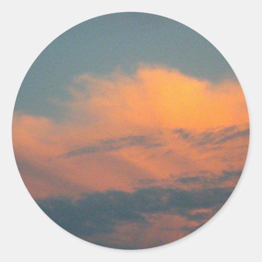Placer de la puesta del sol pegatina redonda
