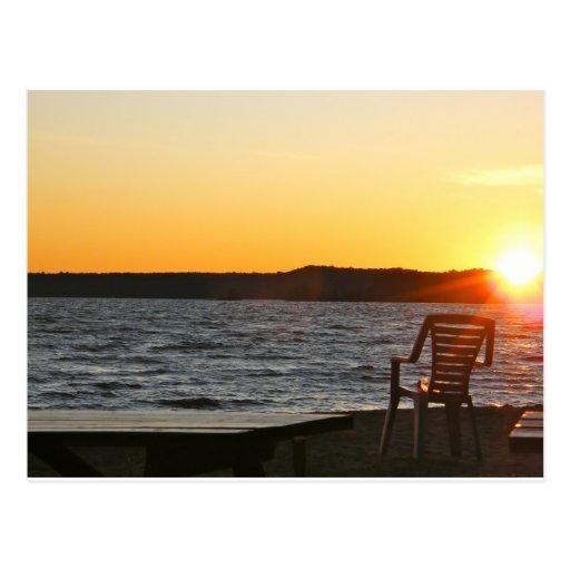 Placer de la puesta del sol postales