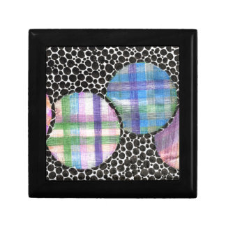 plaid floating on black jewelry boxes