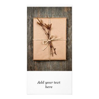 Plain gift with natural decorations photo cards