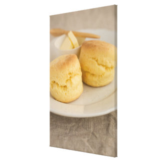 Plain scone with butter on plate canvas print
