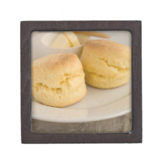 Plain scone with butter on plate jewelry box