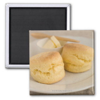 Plain scone with butter on plate fridge magnets