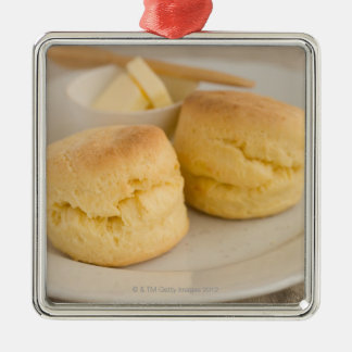 Plain scone with butter on plate metal ornament