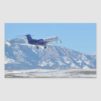 Plane taking off at the airport rectangular sticker