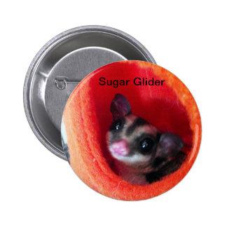 Planeador del azúcar en cama colgante anaranjada pin redondo de 2 pulgadas