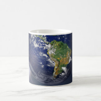 Planet earth rising above the sun in space coffee mug