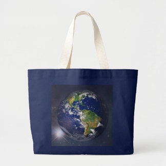 Planet earth rising above the sun in space large tote bag