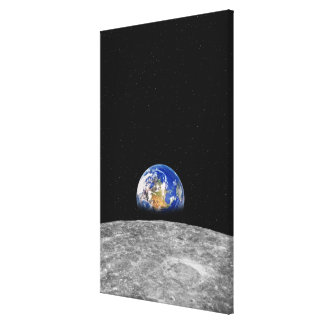 Planet earth rising over Moon Canvas Print