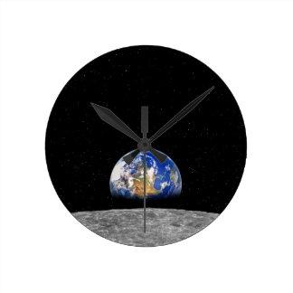 Planet Earth Rising Over Moon Round Wallclocks