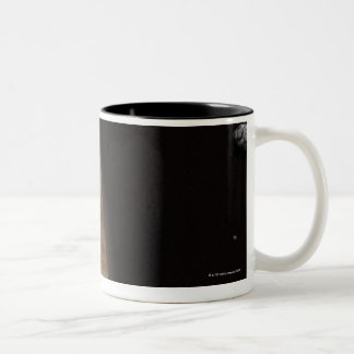 Planet Jupiter and a Distant Moon Two-Tone Coffee Mug