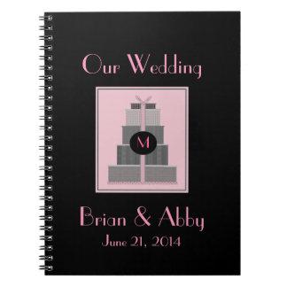 Planificador rosado y negro del boda libro de apuntes