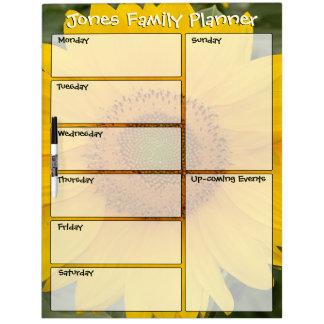 Planificador semanal de la familia soleada del pizarras blancas